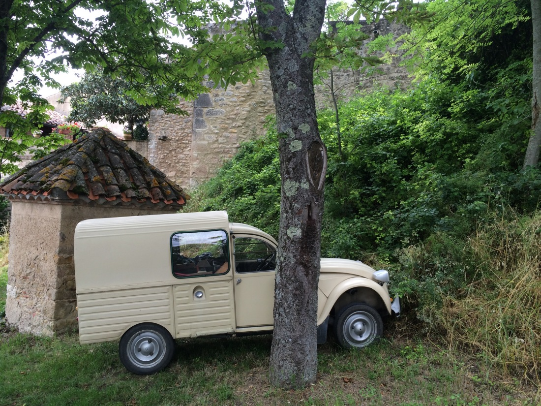 old french delivery truck in light mustard green