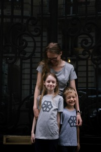 Two children and their mother wearing the NWC Ed.6 grey event t-shirt
